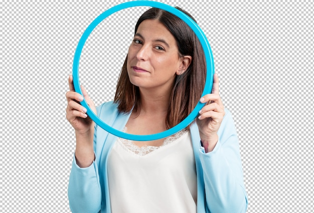 Middle aged woman smiling and relaxed, looking through a frame, funny and creative photo,  photography