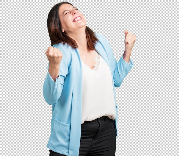 Middle aged woman very happy and excited, raising arms