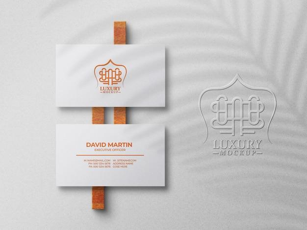 Minimal business card mockup on white surface and logo mockup