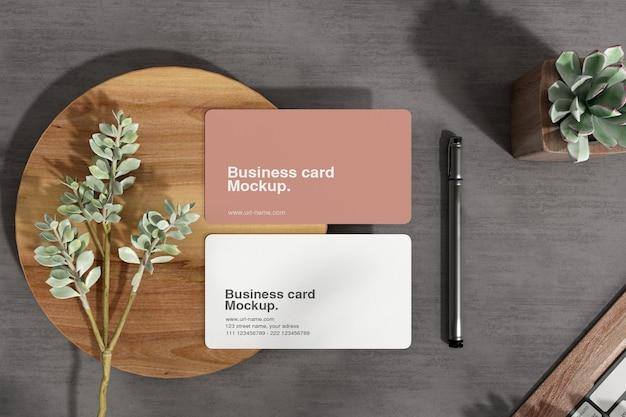 Minimal business card mockup on wood small plate