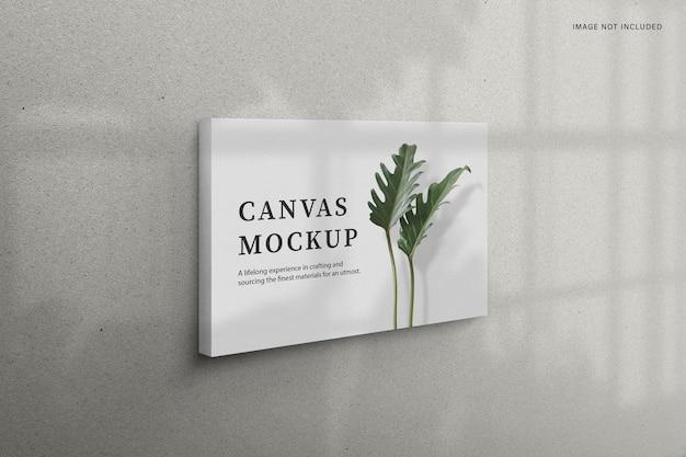 Minimal canvas mockup hanging on the wall