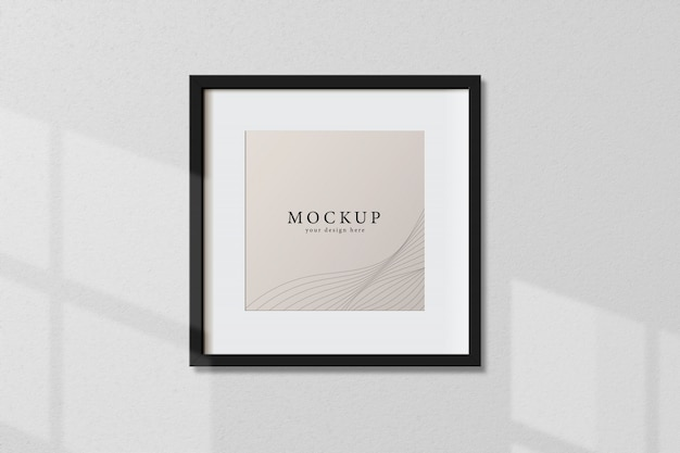 Minimal empty square black frame picture mock up hanging on white wall background with window light and shadow. isolate vector illustration.