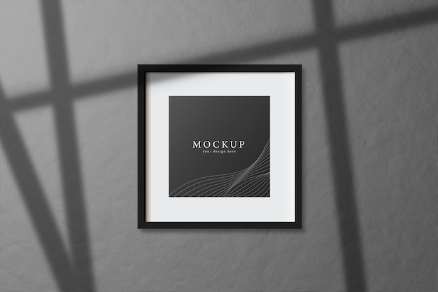 Minimal empty square white frame picture mock up hanging on dark wall background with window light and shadow. isolate vector illustration.