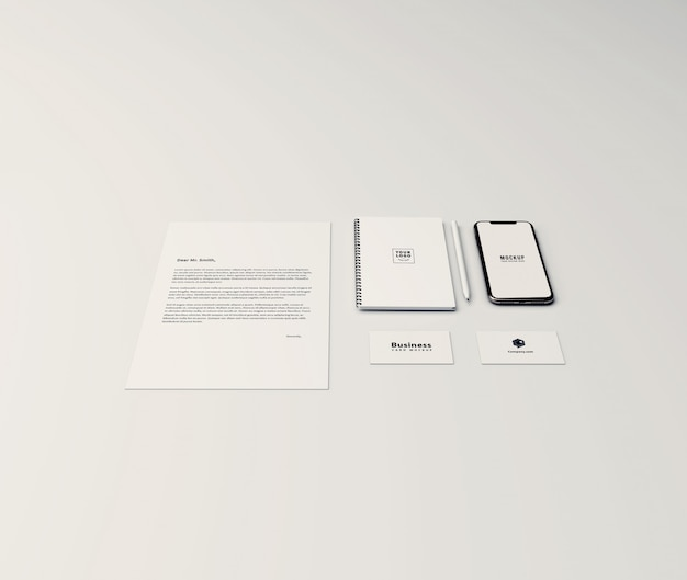 Minimal stationery mockup with mobile phone