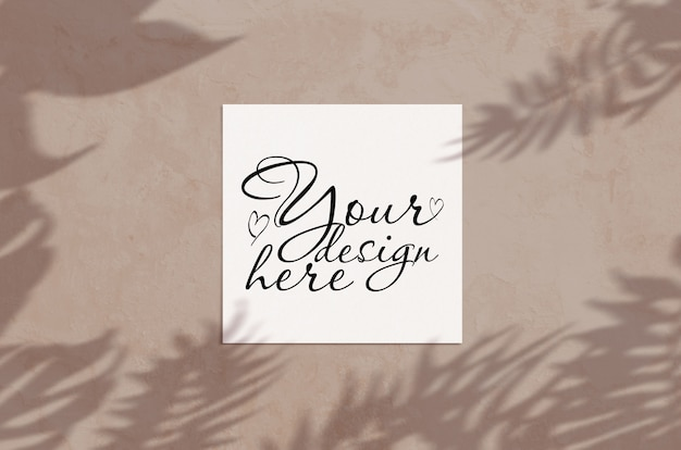 Minimal summer flat lay top view square card mockup on light brown color ground with tropic palm leves shadow
