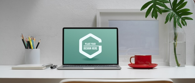 Minimal workspace with mockup laptop