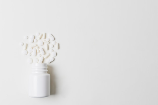 Minimalist bottle of pills copy space mock-up
