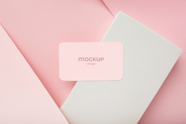 Minimalist business card mockup composition on geometric background with pink and white colors