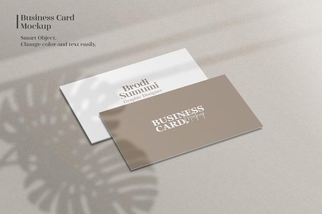 Minimalist business card mockup with monstera leaf shadow