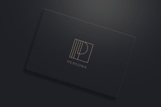Минималистичный макет логотипа на черной визитке