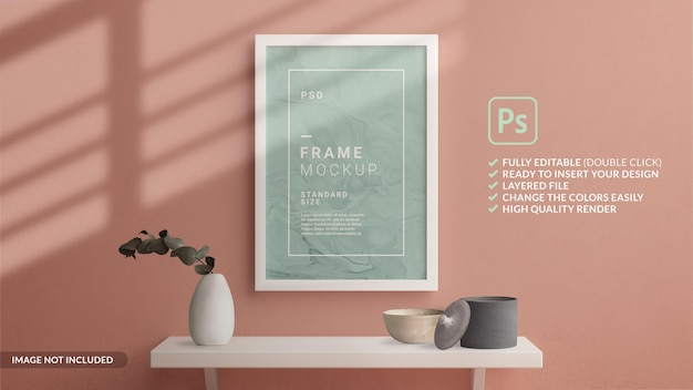 Minimalist vertical frame mockup hanged in the wall with a shelf in 3d rendering
