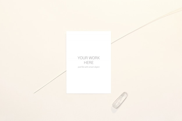 Minimalist wedding card mockup with white stone and branch