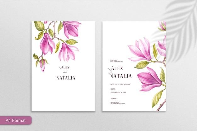 白い背景の上のピンクの花とミニマリストの結婚式の招待状のテンプレート