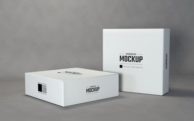 灰色の背景を持つミニマリストの白い四角いボックスのモックアップ