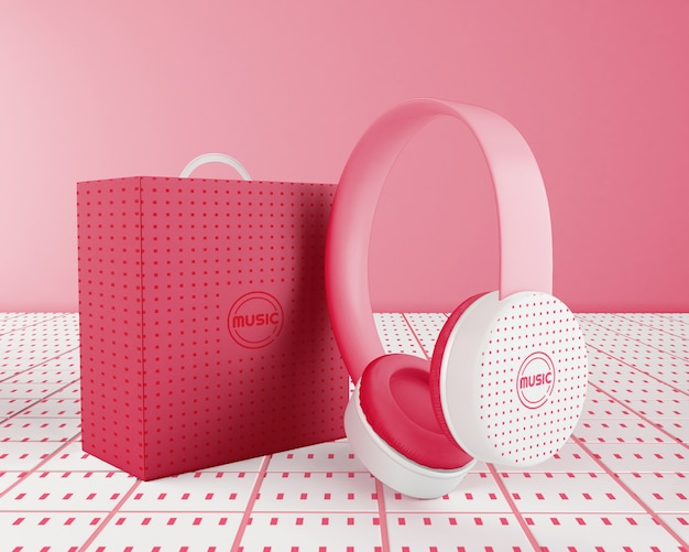 Minimalistic pink headphones arrangement