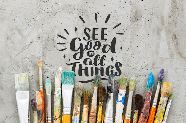 Mix of colorful used brushes with positive message