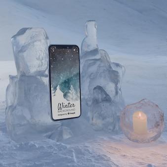 Мобильный на льду горит свет от свечи
