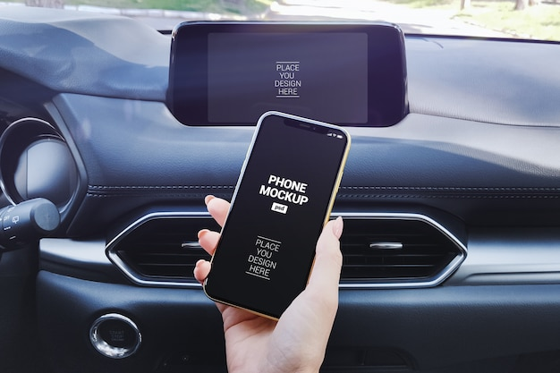 Mobile phone in girl's hand and car multimedia system screen mockup