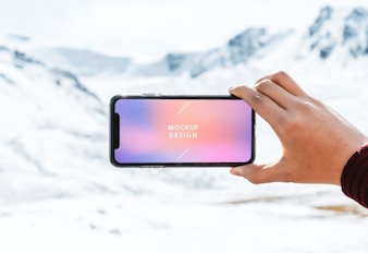 Mobile phone mockup design by the Himalaya mountains