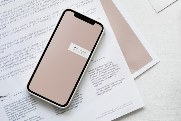 Mobile phone mockup on a paper