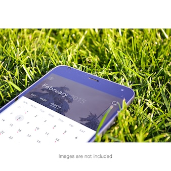 Mobile phone on grass mock up