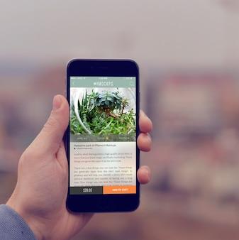 携帯電話の画面には、デザインのモックアップ