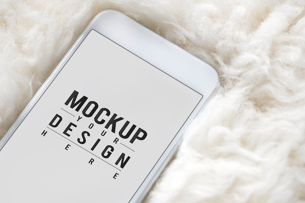 Mobile phone screen mockup on fur surface