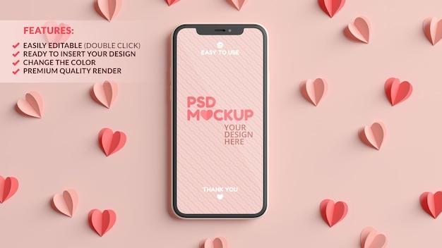 3dレンダリングでピンクと赤の紙のハートと携帯電話の画面のモックアップ