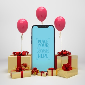 Мобильный телефон в окружении подарков и воздушных шаров