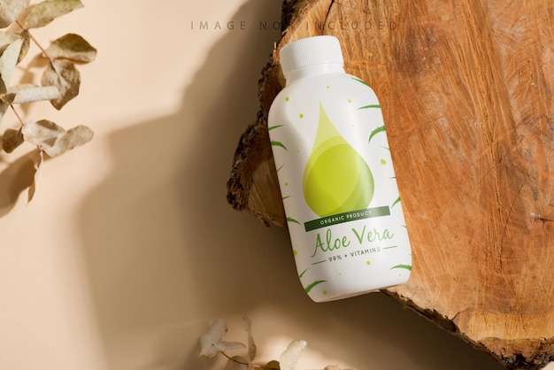 Mock up bottle on a wooden cut and beige surface.