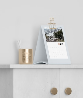 Mock-up cardboard calendar set up on cabinet