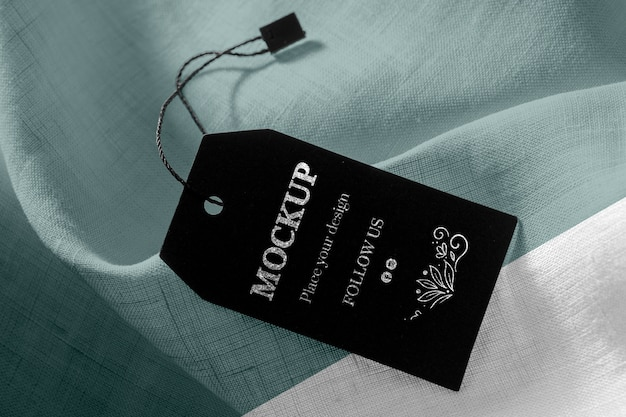 Mock-up of clothing black labels on soft fabric