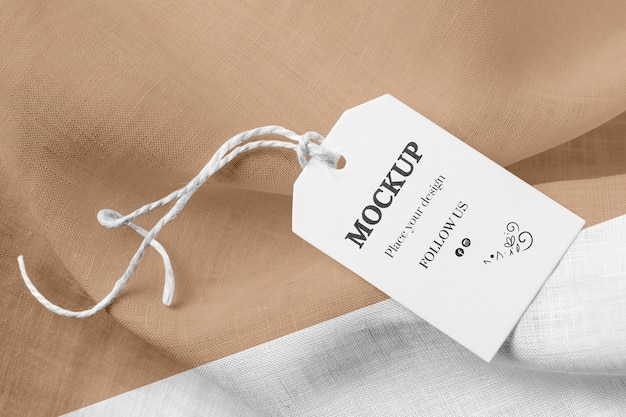 Mock-up of clothing label on brown soft fabric