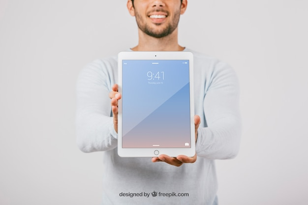 Mock up design with man holding vertical tablet