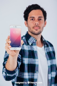 Mock up design of young guy with smartphone