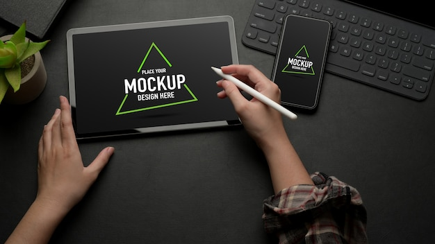 Mock up digital tablet on black table with mock up smartphone and keyboard