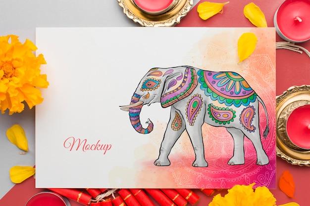 Elefante e fiori di festival indù di diwali di mock-up