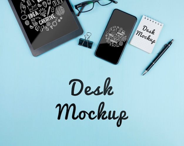 Mock-up electronic devices on desk