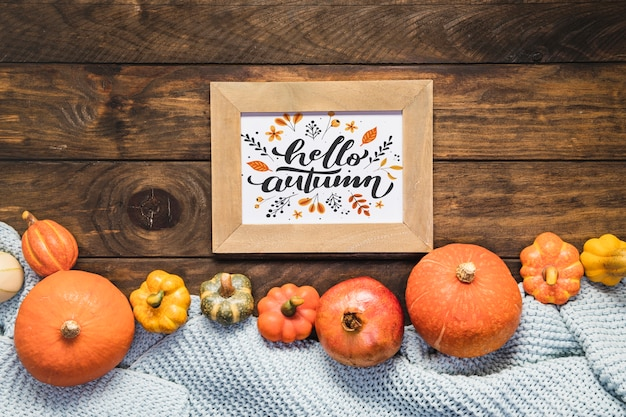 Mock-up frame with hello autumn quote and pumpkins