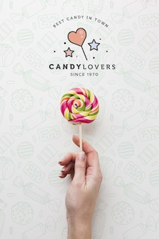Mock-up hand with lollipop