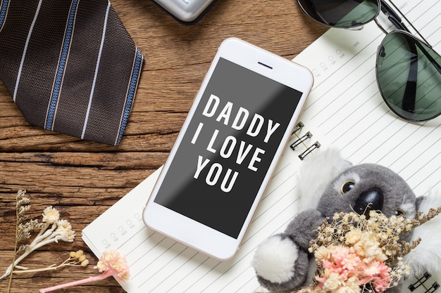 Mock up mobile phone for your artwork with father's accessories items and daughter's toy