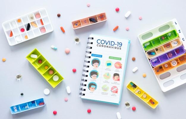 Mock-up notebook beside pills