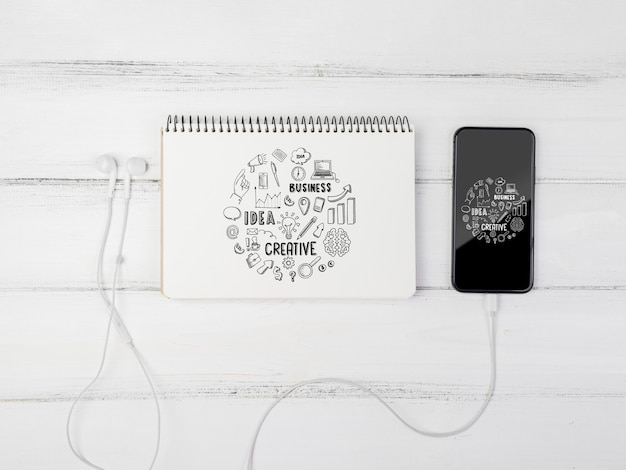 Mock-up notebook with phone beside