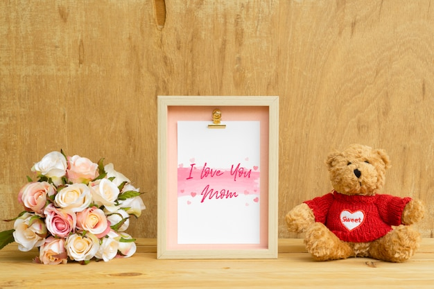 Mock up photo frame with lovely bear and roses bouquet
