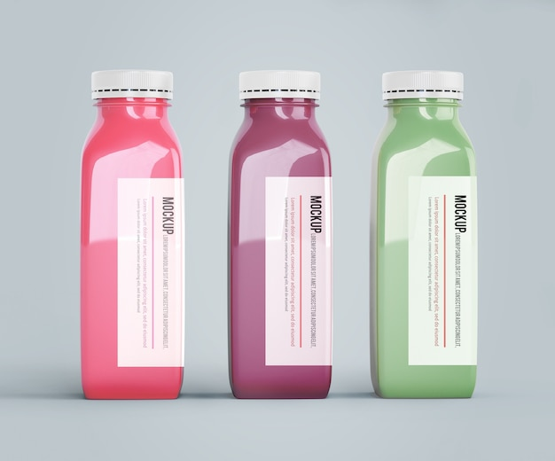 Mock-up plastic bottles with different fruit or vegetable juices