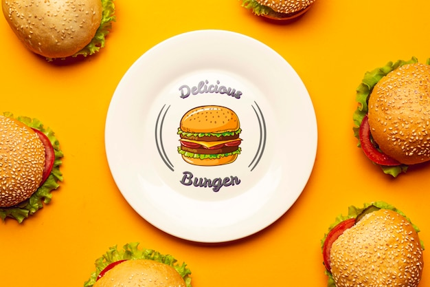 Mock-up plate surrounded by delicious burgers