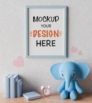 ベビーシャワーの3dレンダリングのためのかわいい象の人形でポスターフレームをモックアップ