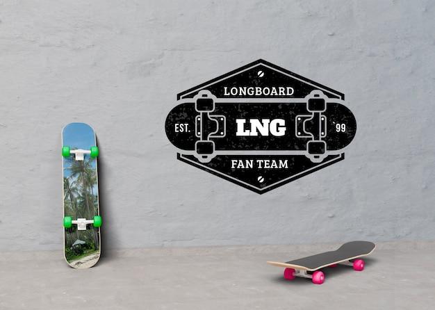 Mock-up skateboards next to logo