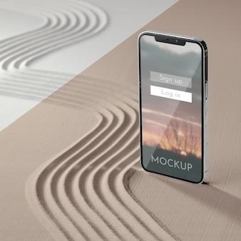 砂の詰め合わせでスマートフォンをモックアップ