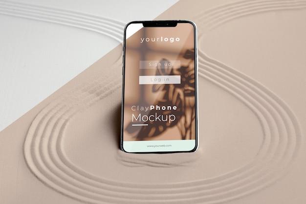 Smartphone mock-up in composizione sabbia
